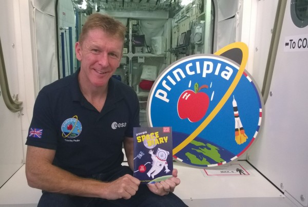 Astronaut Tim Peake with Principia Space Diary by Kristen Harrison, Lucy Hawking, Peter McOwan and Ben Hawkes